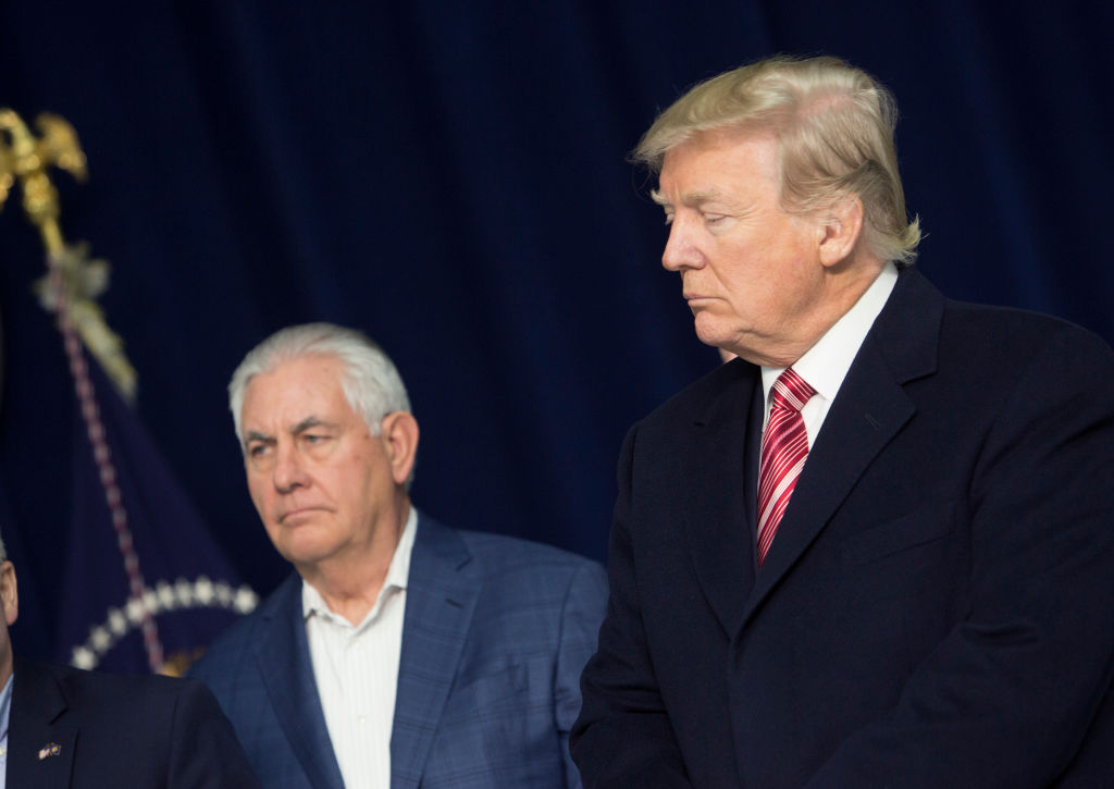 U.S. Secretary of State Rex Tillerson and U.S. President Donald Trump listen as Republicans take turns speaking to the media at Camp David on January 6, 2018 in Thurmont, Maryland.