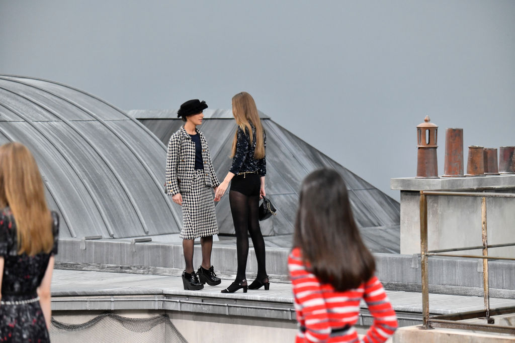 Gigi Hadid confronts YouTube's Marie S'Infiltre on the Chanel catwalk on Oct. 1, 2019 in Paris, France.