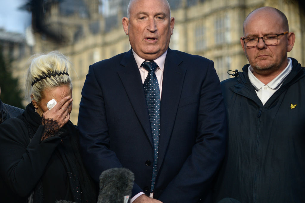 Family spokesman Radd Seiger speaks on behalf of father of Harry Dunn, Tim Dunn (R) and mother Charlotte Charles (L) after meeting with Foreign Secretary Dominic Raab on Oct. 9, 2019 in London, England. Motorcyclist Harry Dunn, 19, died in a collision with a car in Northamptonshire on Aug. 27 this year.