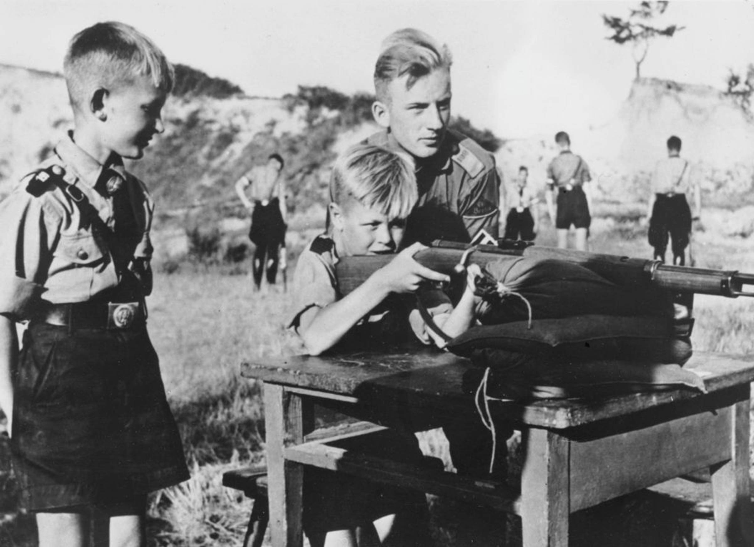 Eleven-year-old boys in the Hitler Youth organization learning how to fire a rifle.