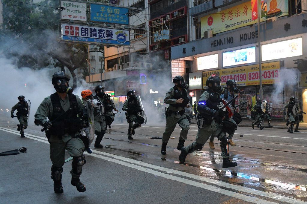 Hong Kong police advance on protesters during clashes in Hong Kong on Oct. 6, 2019.