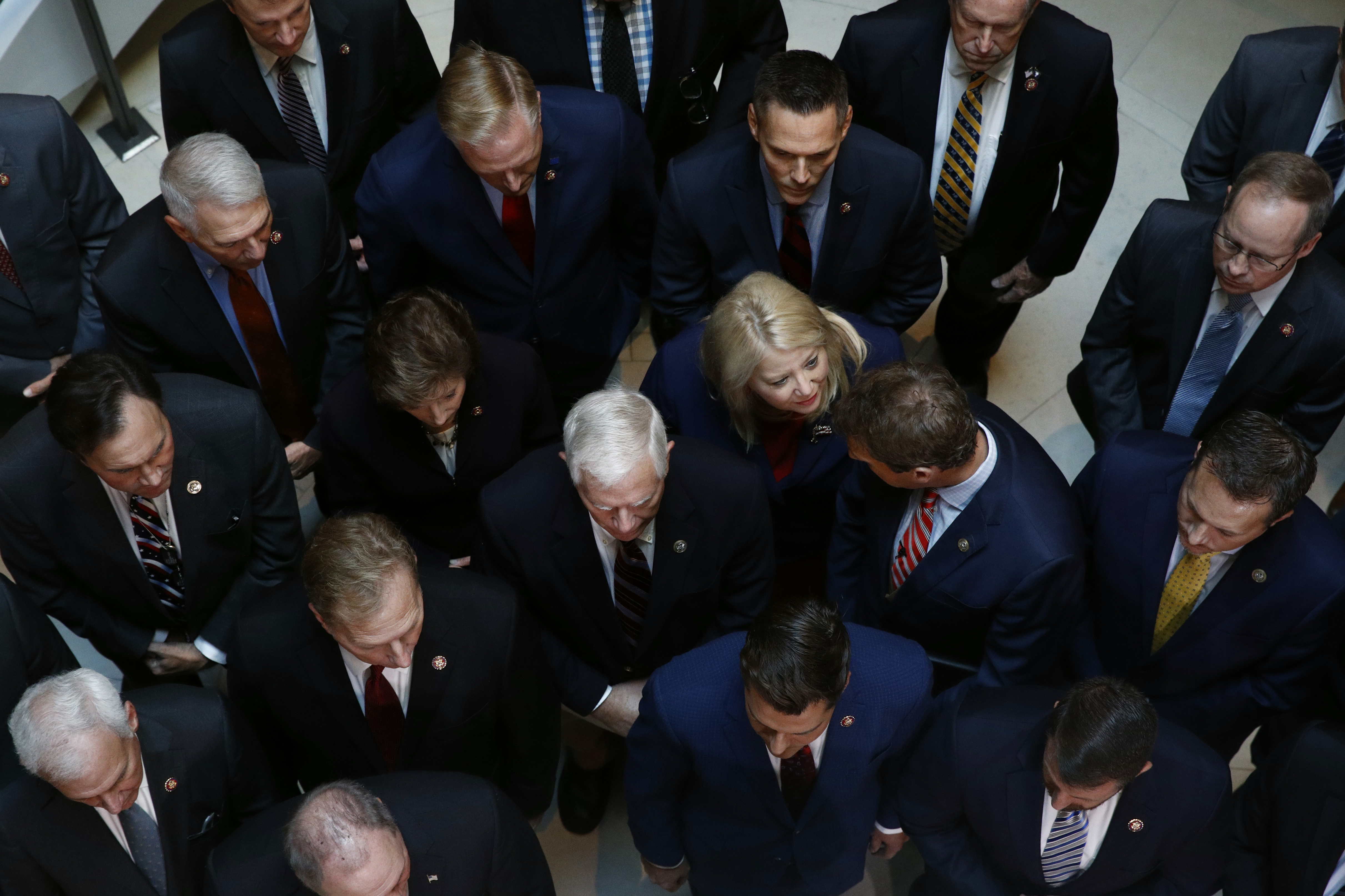 Rep. Debbie Lesko, R-Ariz., center, gathers with fellow House Republicans for a news conference after Deputy Assistant Secretary of Defense Laura Cooper arrived for a closed-door meeting to testify as part of the House impeachment inquiry into President Donald Trump, Wednesday, Oct. 23, 2019, on Capitol Hill in Washington.