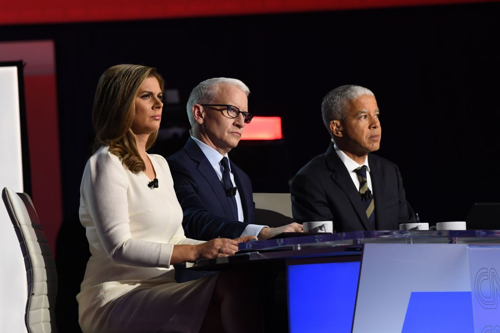 Moderator and The New York Times national editor Marc Lacey, moderator and CNN anchor Anderson Cooper and moderator and CNN anchor Erin Burnett look on during the fourth Democratic primary at Otterbein University in Westerville, Ohio on October 15, 2019.