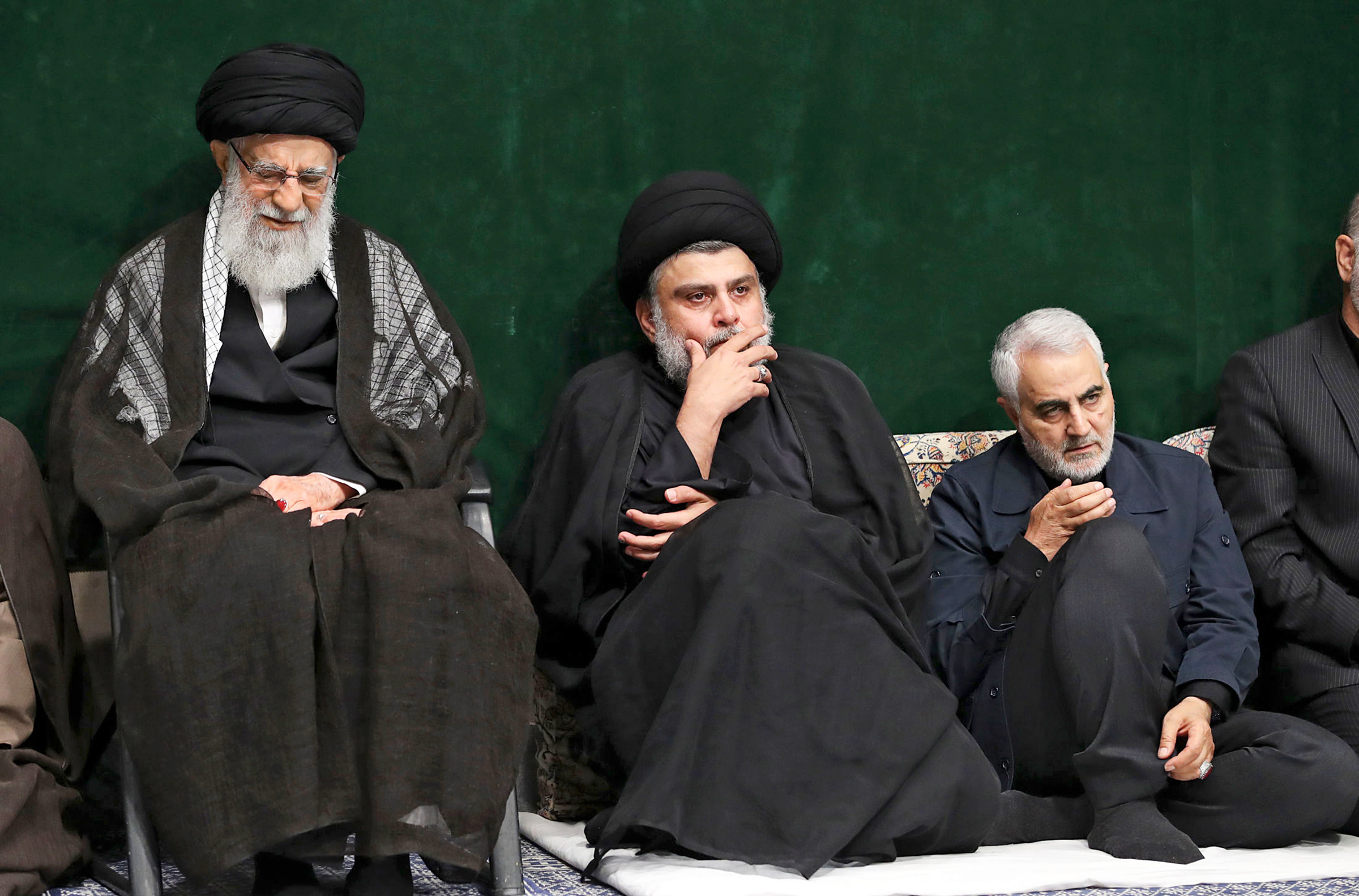 Khamenei and Qasem Soleimani flank Iraqi cleric Muqtada al-Sadr at a Tehran mourning ceremony on Sept. 10