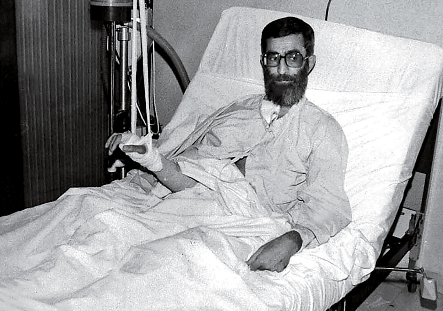 Recovering in a Tehran hospital from a 1981 bomb blast that cost him the use of his right hand
