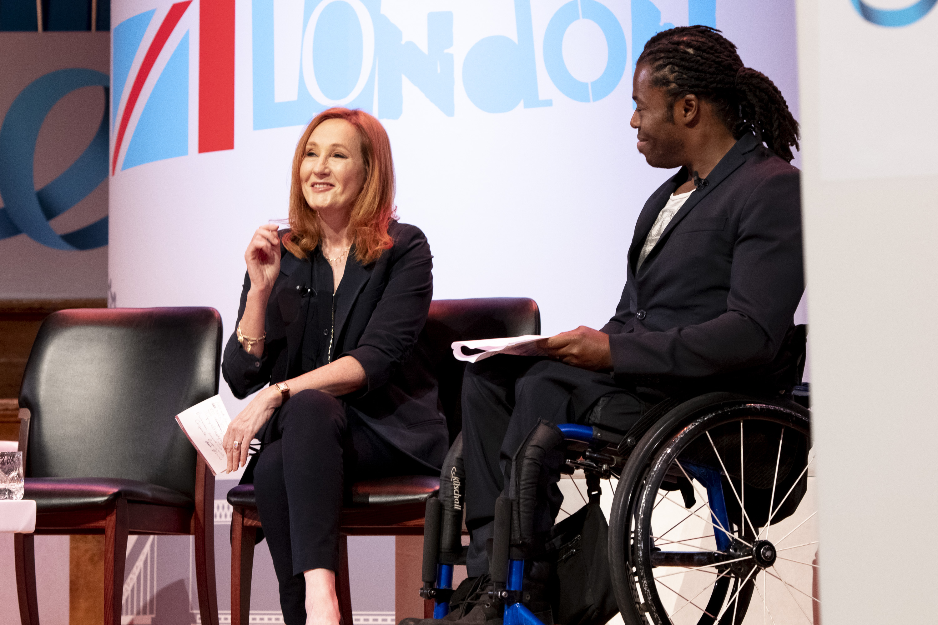 The author J.K. Rowling alongside U.K. paralympian Ade Adepitan at the One Young World global forum in London on Oct. 24