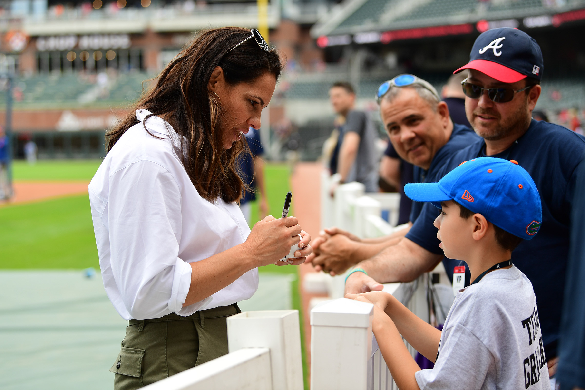 ESPN baseball broadcaster Jessica Mendoza signs autographs at SunTrust Park in Atlanta on April 12, 2019.