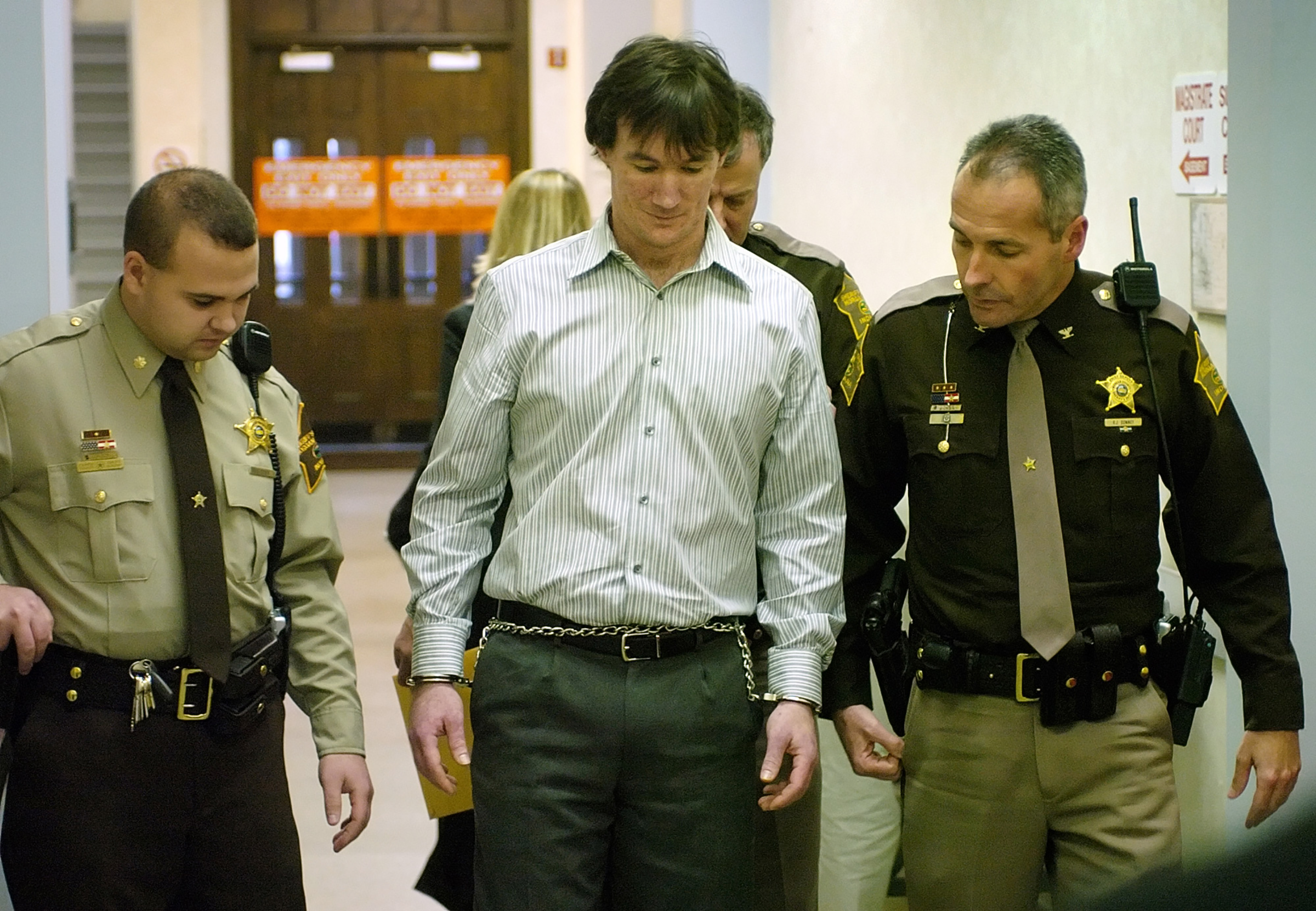 John Myers II, center, is escorted from the Morgan County Courthouse Friday, Dec. 1, 2006, after receiving a sentence of 65 years in prison for the murder Jill Behrman, 19, in May 2000.