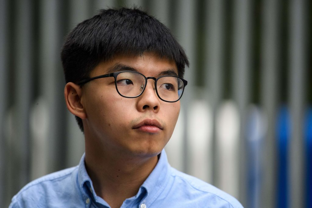 Pro-democracy activist Joshua Wong speaks to the media outside the Legislative Council (LegCo) in Hong Kong after he was barred from standing in an upcoming local election on Oct. 29, 2019.