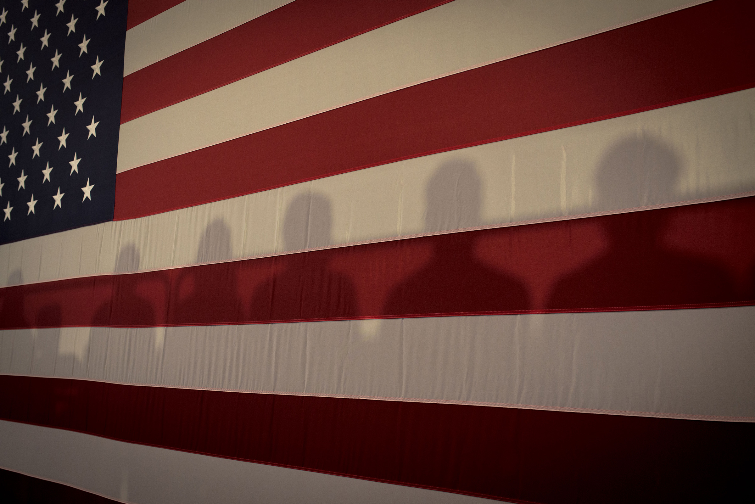 Shadows on an American Flag at Cedar Rapids Town Hall with Kamala Harris in Cedar Rapids, Iowa, Sept. 19, 2019.