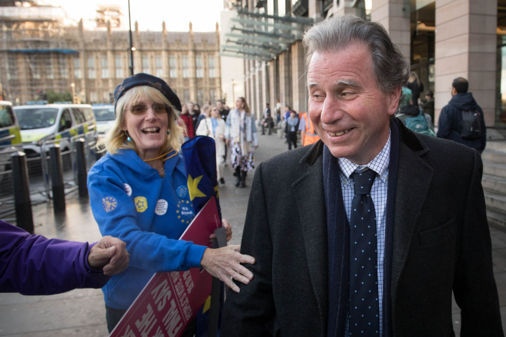 Oliver Letwin, the lawmaker who succeeded in thwarting a vote on Boris Johnson's Brexit deal on Saturday, is congratulated by anti-Brexit protesters outside Parliament on Oct. 19 in central London