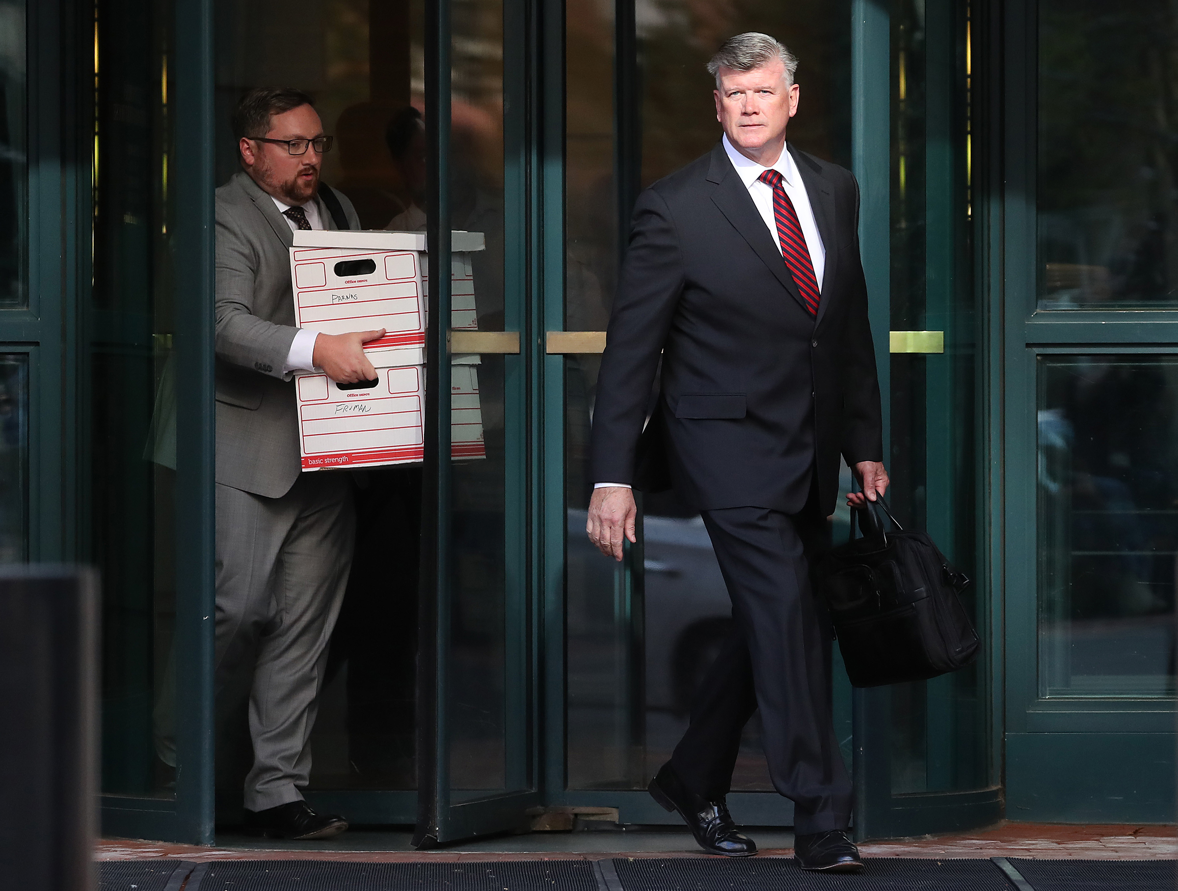Attorney Kevin Downing, right, who is representing two associates of Rudy Giuliani, Lev Parnas and Igor Fruman, walks out of a federal courthouse after a hearing in Alexandria, Va., on Oct. 10, 2019.