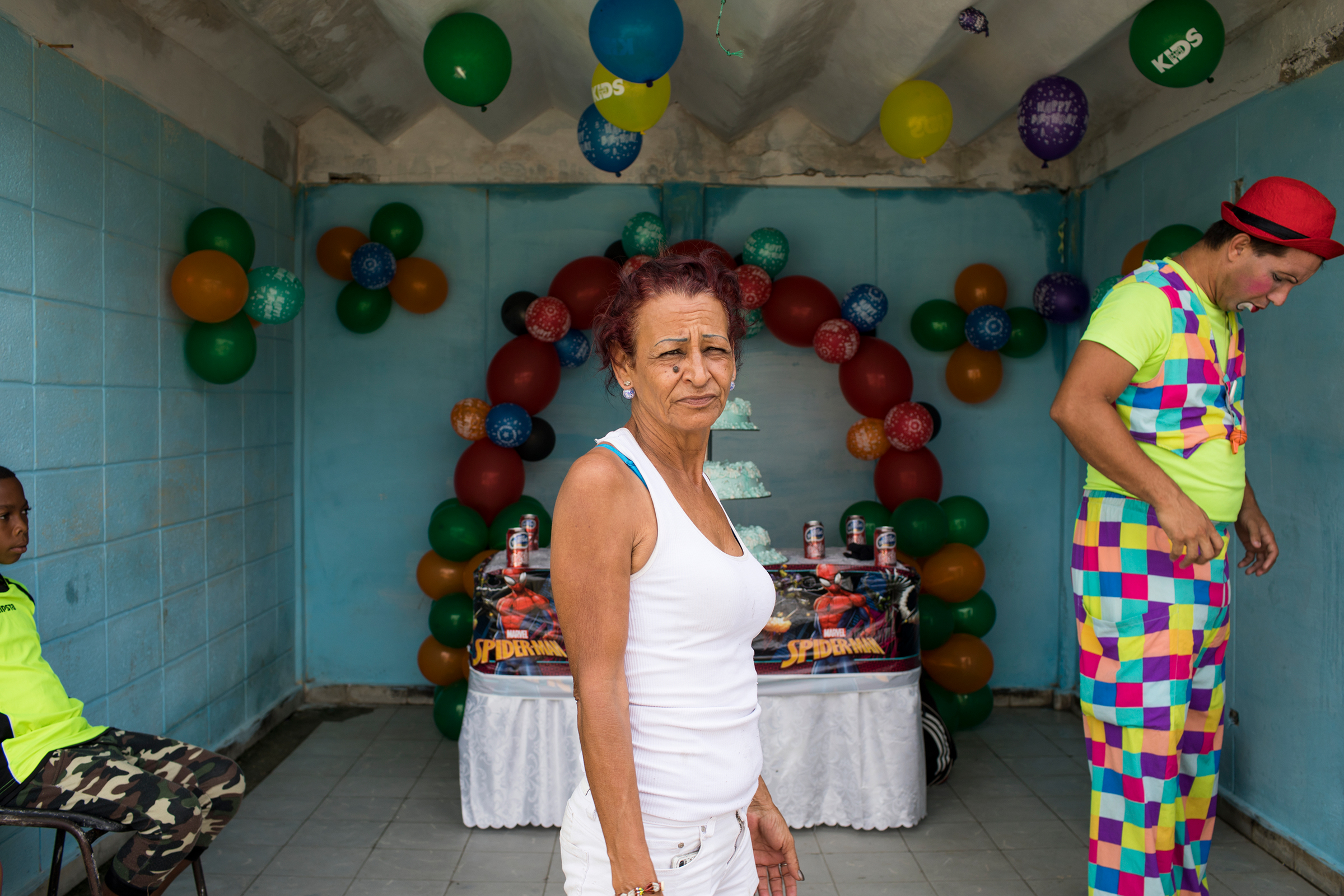 Marta celebrates her grandson's birthday in Cuba on May 27, 2018. She is able to return frequently and enjoys being able to bring small comforts to her family. Her main motivation for migrating to the U.S. was to be able to provide for her kids and grandson. When she returns to Las Yaguas, her block in Havana, everyone knows her. She still feels at home.