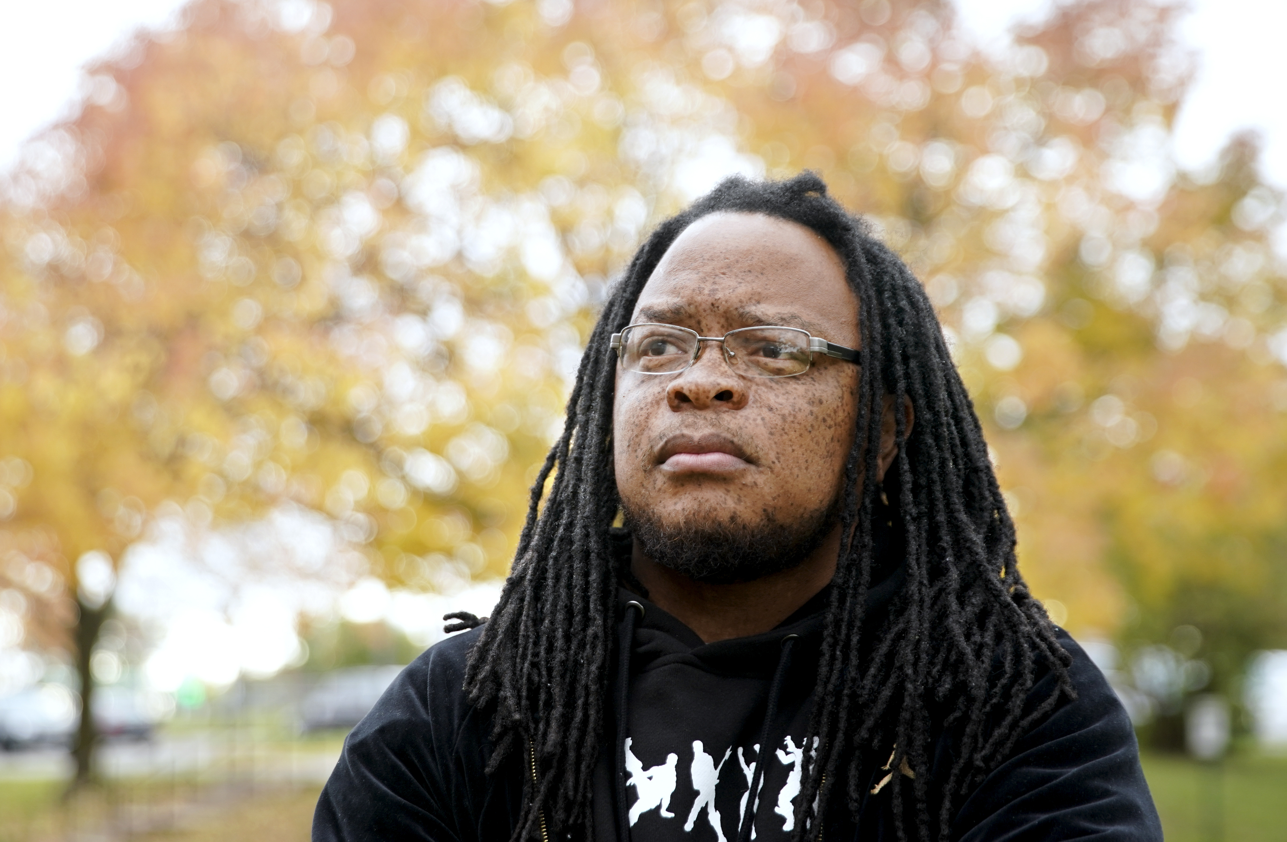 FILE - In this Oct. 17, 2019, file photo, Marlon Anderson poses for a photo in Madison, Wis. A Wisconsin school district is rehiring Anderson, a security guard after he was fired last week for repeating a racial slur while telling a student not to use it, a union official said Monday, Oct. 21. (Steve Apps/Wisconsin State Journal via AP)