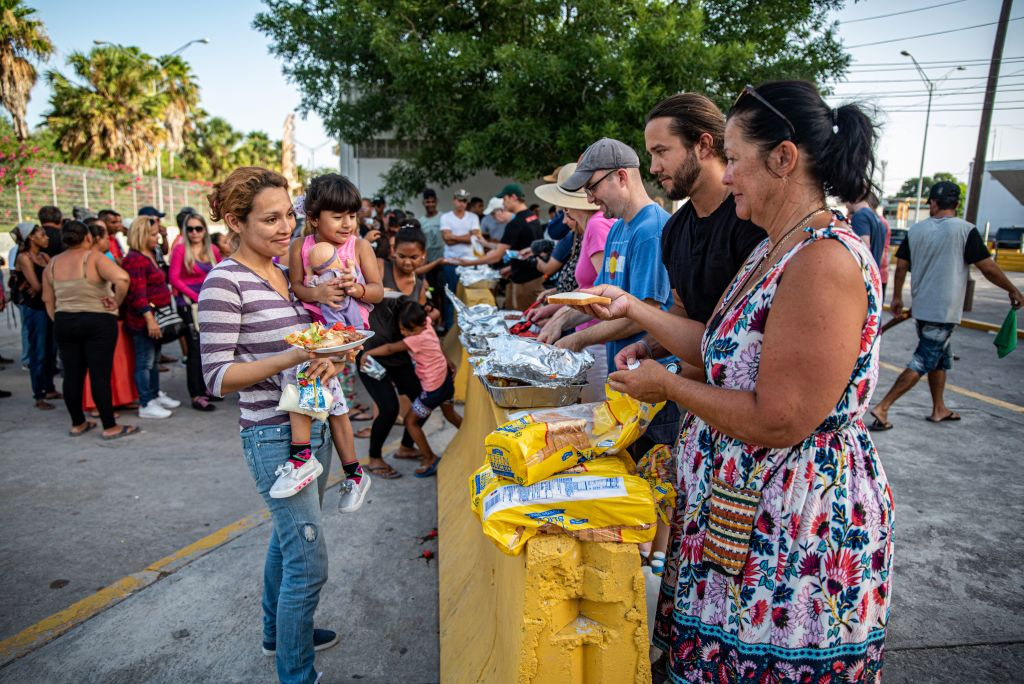 Volunteers hand out food to migrants near the Mexican border in Matamoros, Tamaulipas on June 29, 2019.