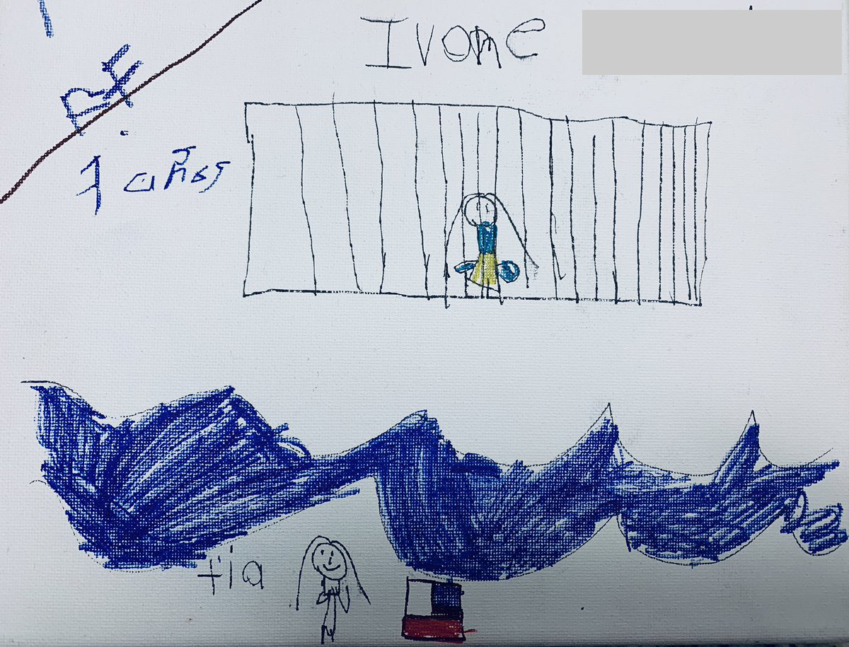 Ivone, 7, draws herself in a cage while her tía watches across the Rio Grande river next to an American flag.