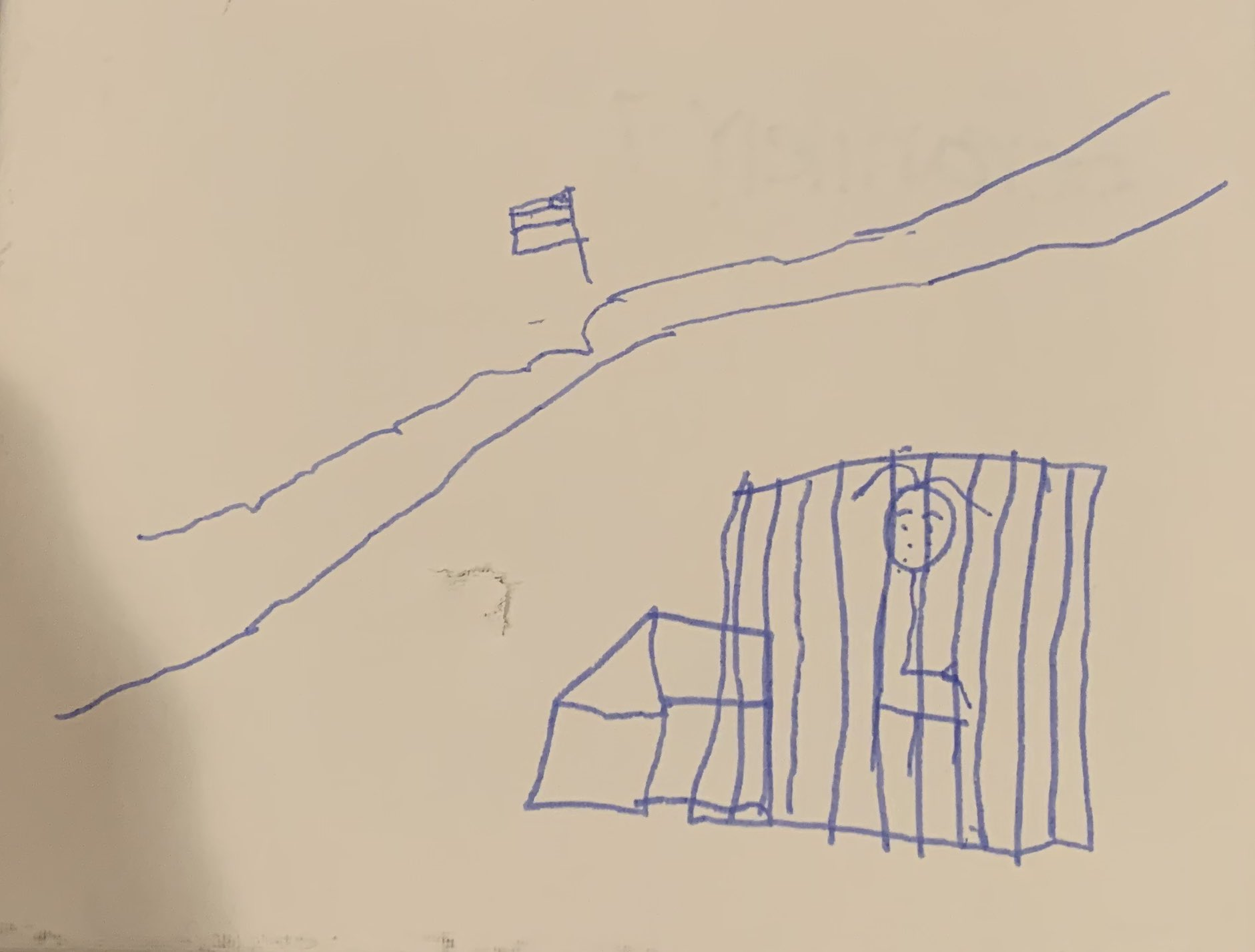 An unidentified 7-year-old child living at a tent encampment in Matamoros, across the border from Brownsville, Texas, draws herself in a cage.