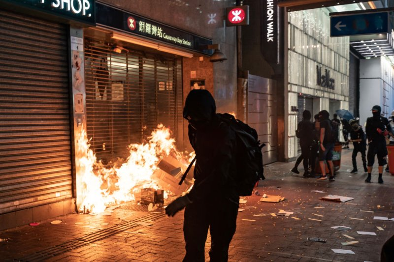 Pro-democracy protesters set a fire at the entrance of a subway station in Hong Kong on Oct. 4, 2019.