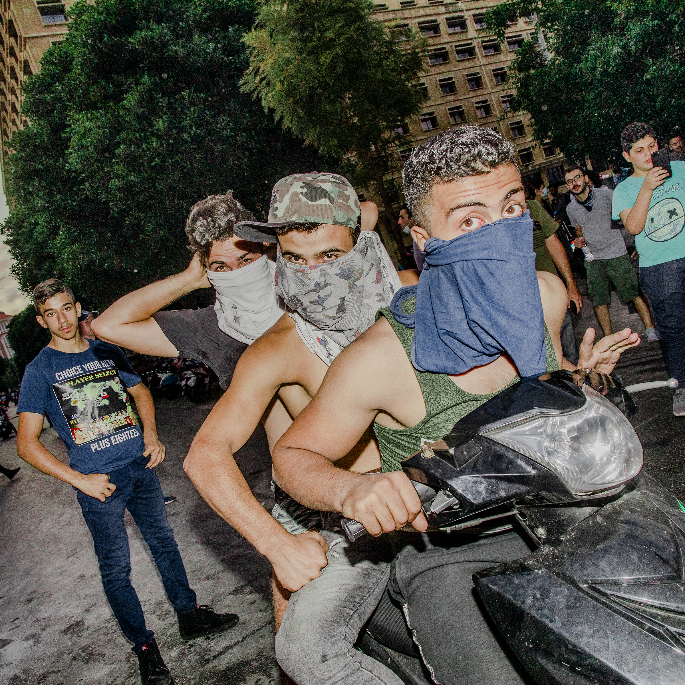 Young men on a motorcycle at a mass protest in Beirut on Oct. 18, 2019.