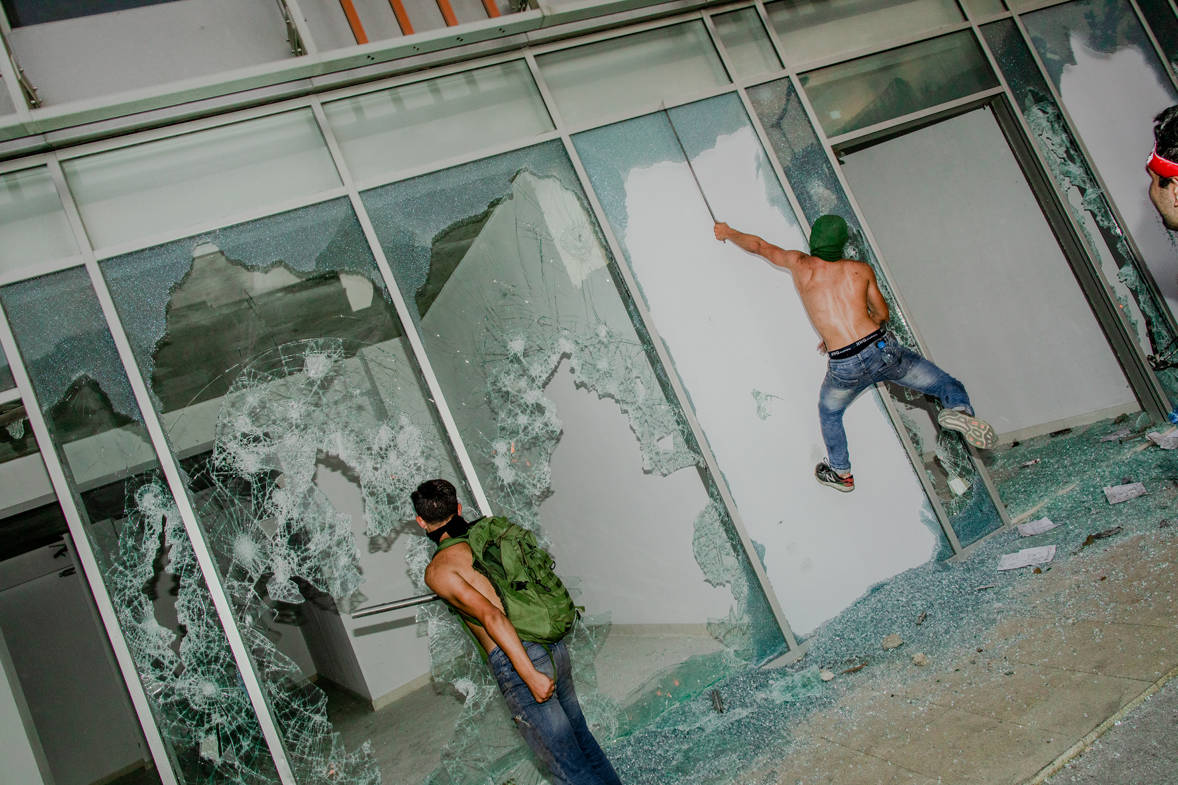 Young men smashing shop windows on the first day of protests in Beirut on Oct. 18, 2019.