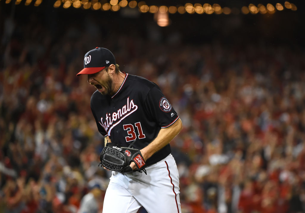 Max Scherzer #31 of the Washington Nationals celebrates as he walks back to the dug out after the last out with bases loaded in the seventh inning of game four of the National League Division Series against the Los Angeles Dodgers at Nationals Park on October 07, 2019 in Washington, D.C.