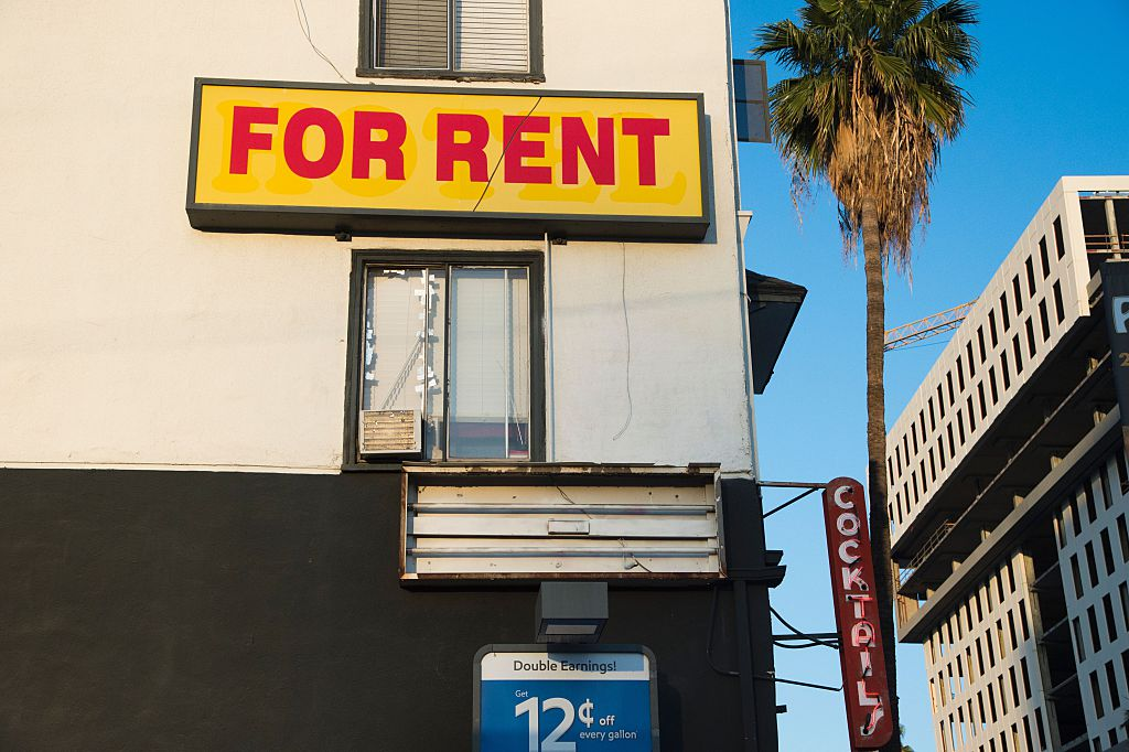 A  For Rent  sign is seen on a building Hollywood, California, May 11, 2016. Angelinos are feeling the increasing burden of rising rents and threats of eviction as forecast indicate rent prices will continue to rise through 2018.