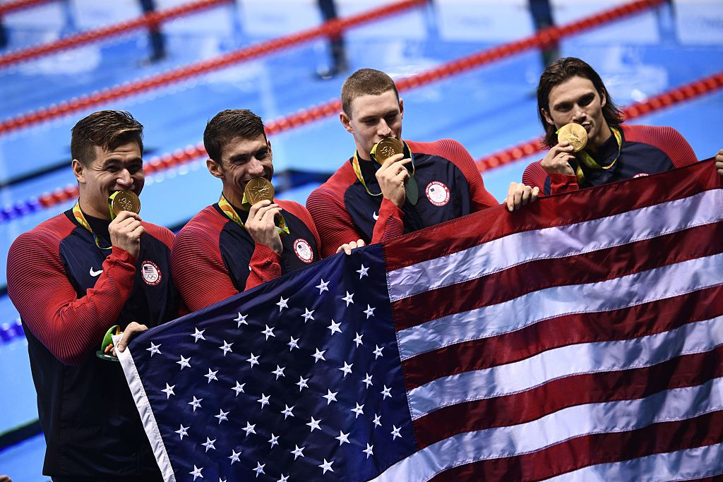 Team USA's gold medallists Ryan Murphy, Cody Miller, Michael Phelps, Nathan Adrian pose during the podium ceremony of the Men's swimming 4 x 100m Medley Relay Final at the Rio 2016 Olympic Games at the Olympic Aquatics Stadium in Rio de Janeiro on August 13, 2016.
