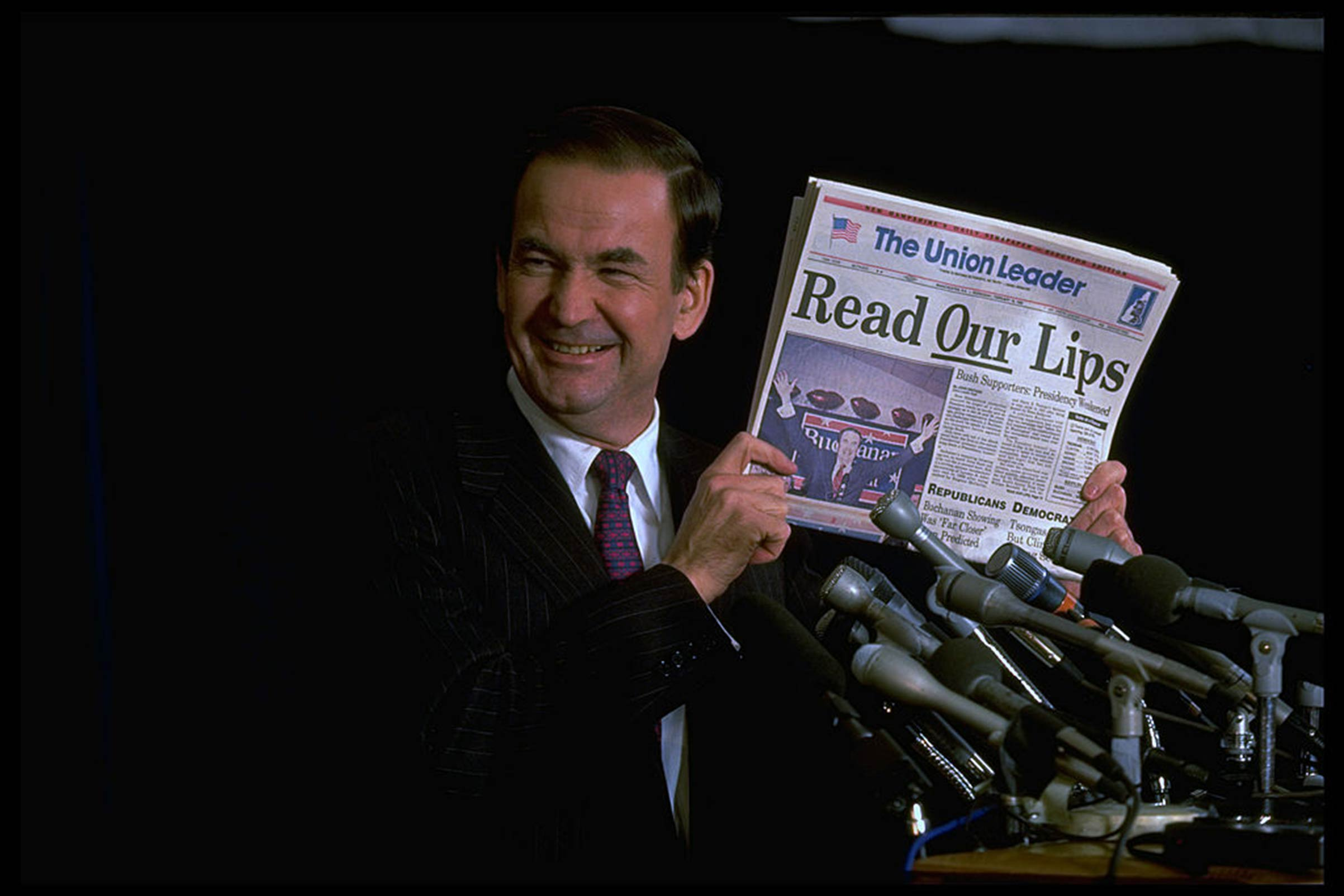 Conservative Republican presidential hopeful Pat Buchanan displaying The New Hampshire Union Leader headlining his triumph and threat to frontrunner and incumbent President George H.W. Bush on Feb. 1, 1992.