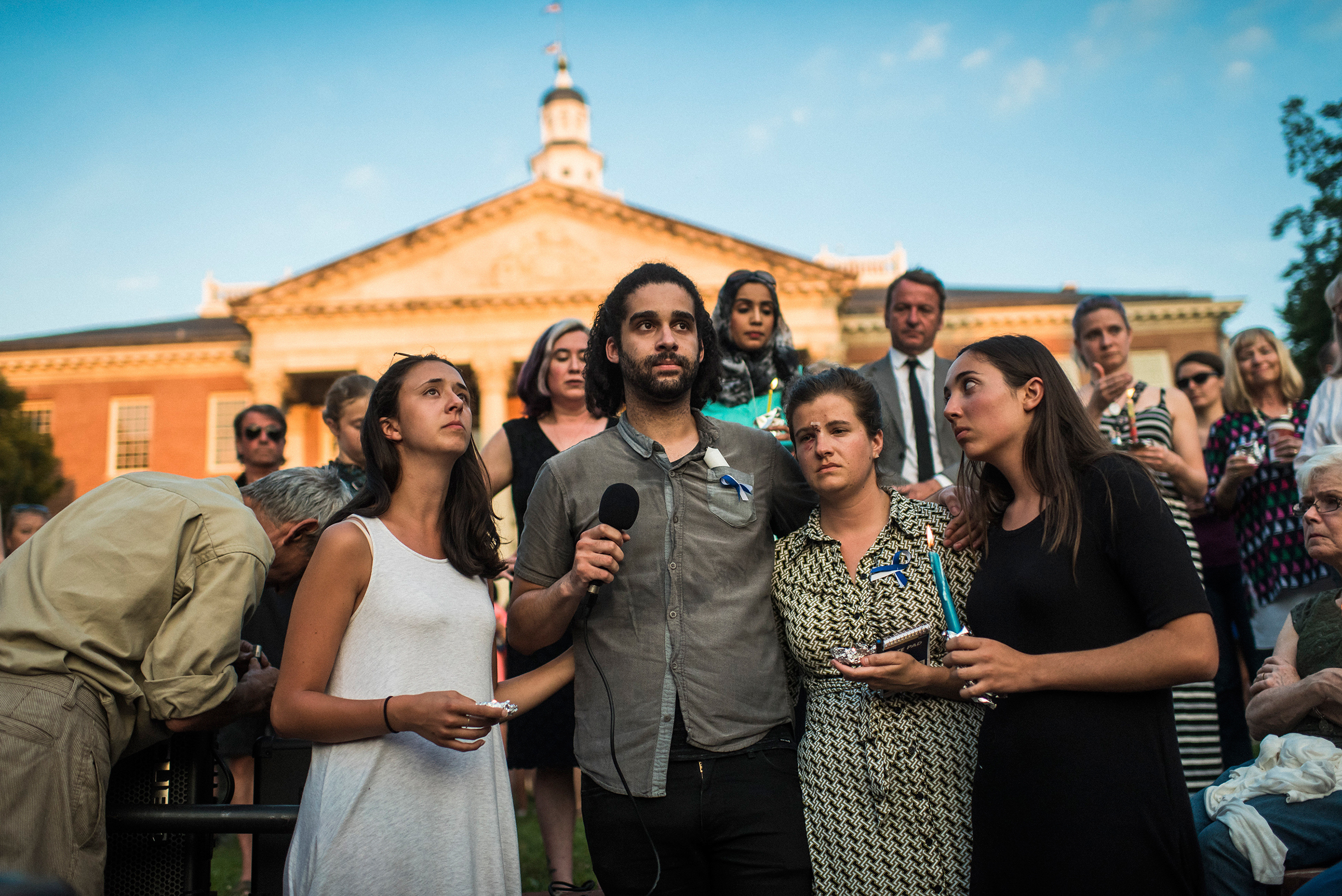 From left: Danielle Ohl, Phil Davis, Rachael Pacella and Selene San Felice—reporters at the Capital Gazette—address the crowd during a June 29, 2018, vigil for the victims of the newsroom shooting in Annapolis, Md.
