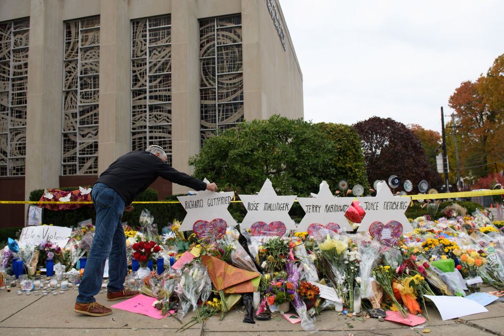 Mourners visit the memorial outside the Tree of Life Synagogue on October 31, 2018 in Pittsburgh, Pennsylvania.