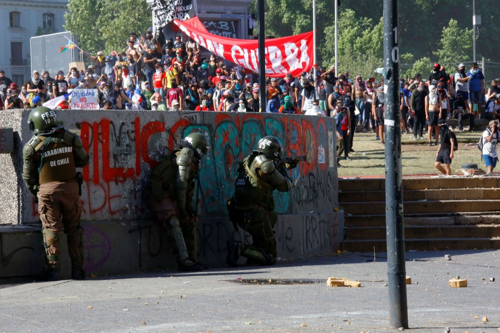 SANTIAGO, CHILE - OCTOBER 24: Security forces intervene in protests in Santiago, Chile on Oct. 24, 2019.