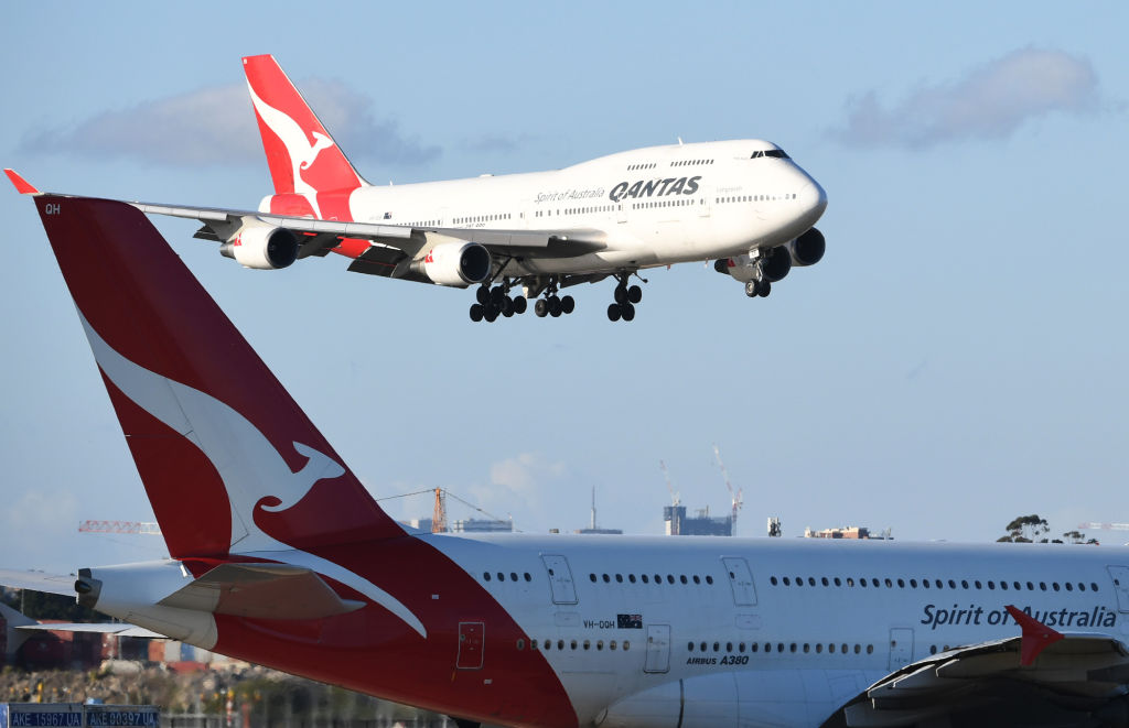 Qantas flight number 4 from Honolulu, a Boeing 747-400 aircraft flies over a Qantas A380 aircraft as she arrives at Sydney Airport on September 30, 2018 in Sydney, Australia. Friday's flight from New York is a key test for Qantas as it prepares to start direct commercial services to Sydney as soon as 2022.