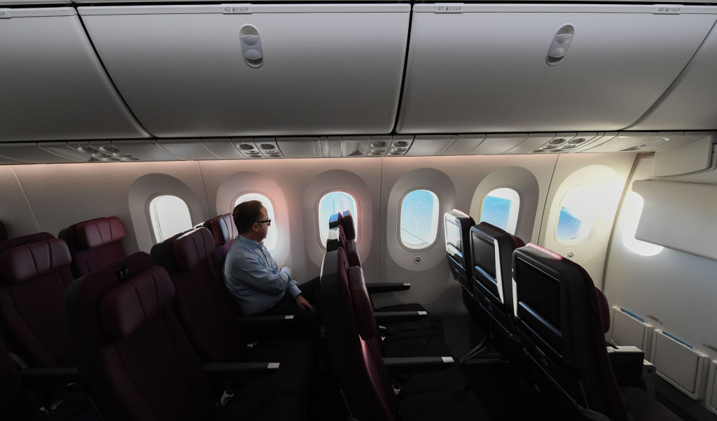 Alan Joyce, Qantas Group CEO sits onboard Qantas flight 7879 as the sun rises in Australia after flying 19 hours and 16 minutes from New York to Sydney on October 20, 2019 in Sydney, Australia.