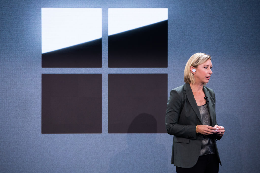 Robin Seiler, vice president of program management and devices at Microsoft Corp., wears the Microsoft Surface Earbuds while speaking during an event in New York, U.S., on Wednesday, Oct. 2, 2019.
