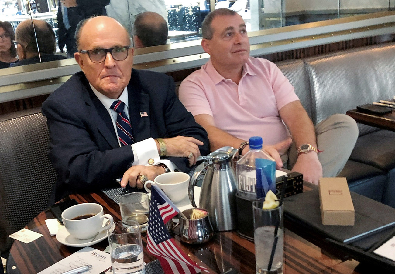 Giuliani and his client Lev Parnas on Sept. 20 at the Trump hotel in D.C.