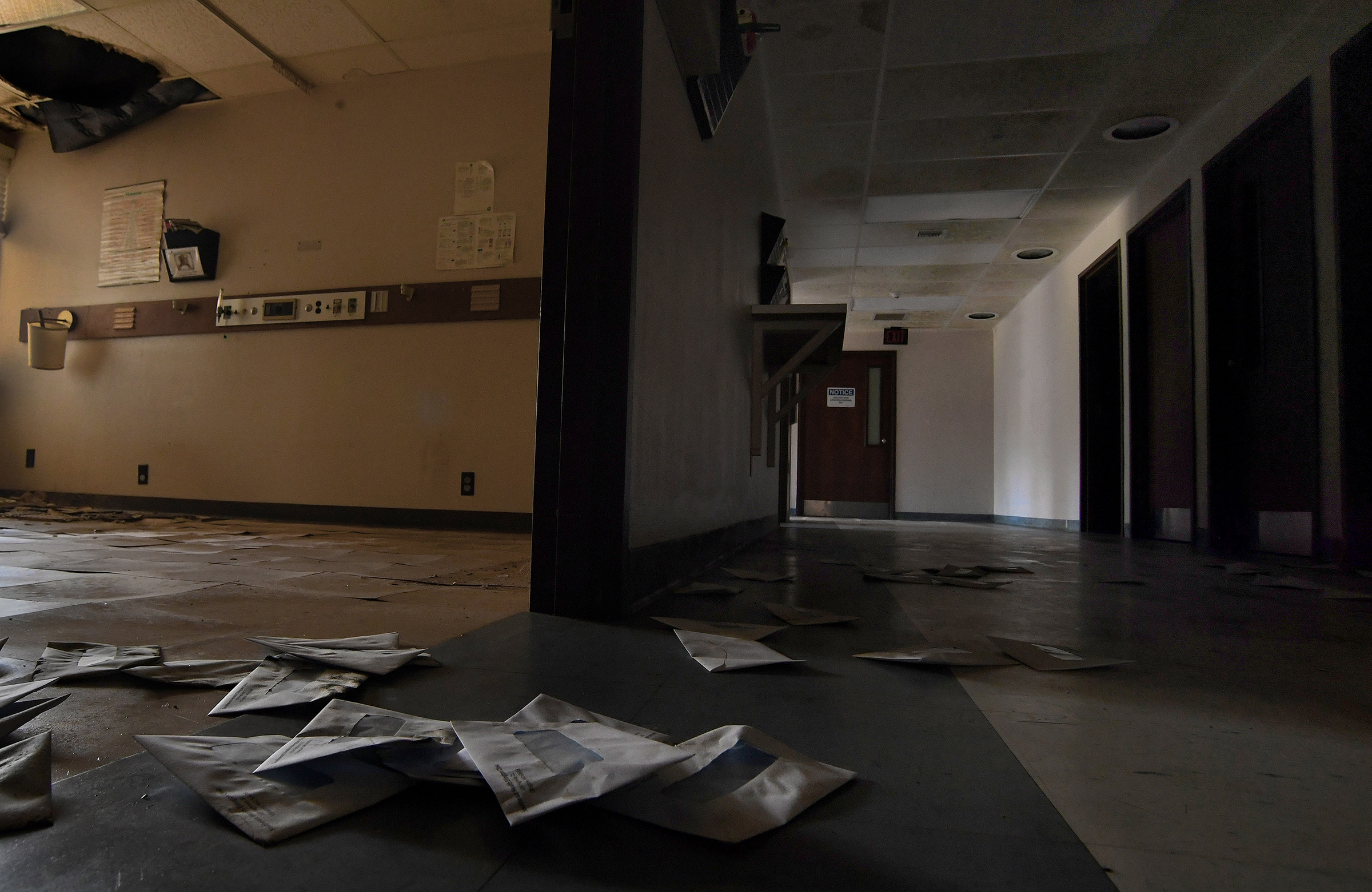 Billing envelopes litter the floor of the shuttered Southeast Health Center                     in Ellington, Missouri on July 19, 2019.