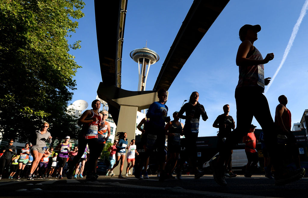 Competitors run with the monorail and Space Needle in the background during the 2019 Rock'n'Roll Seattle Marathon and 1/2 Marathon on June 9, 2019 in Seattle, Washington.