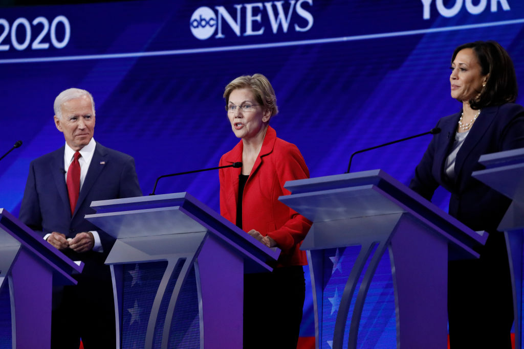 2020 Democratic presidential candidates Joe Biden, Elizabeth Warren and Kamala Harris stand at the Democratic debate stage from Texas Southern University's Health & PE Center in Houston, TX on Thursday, September 12.