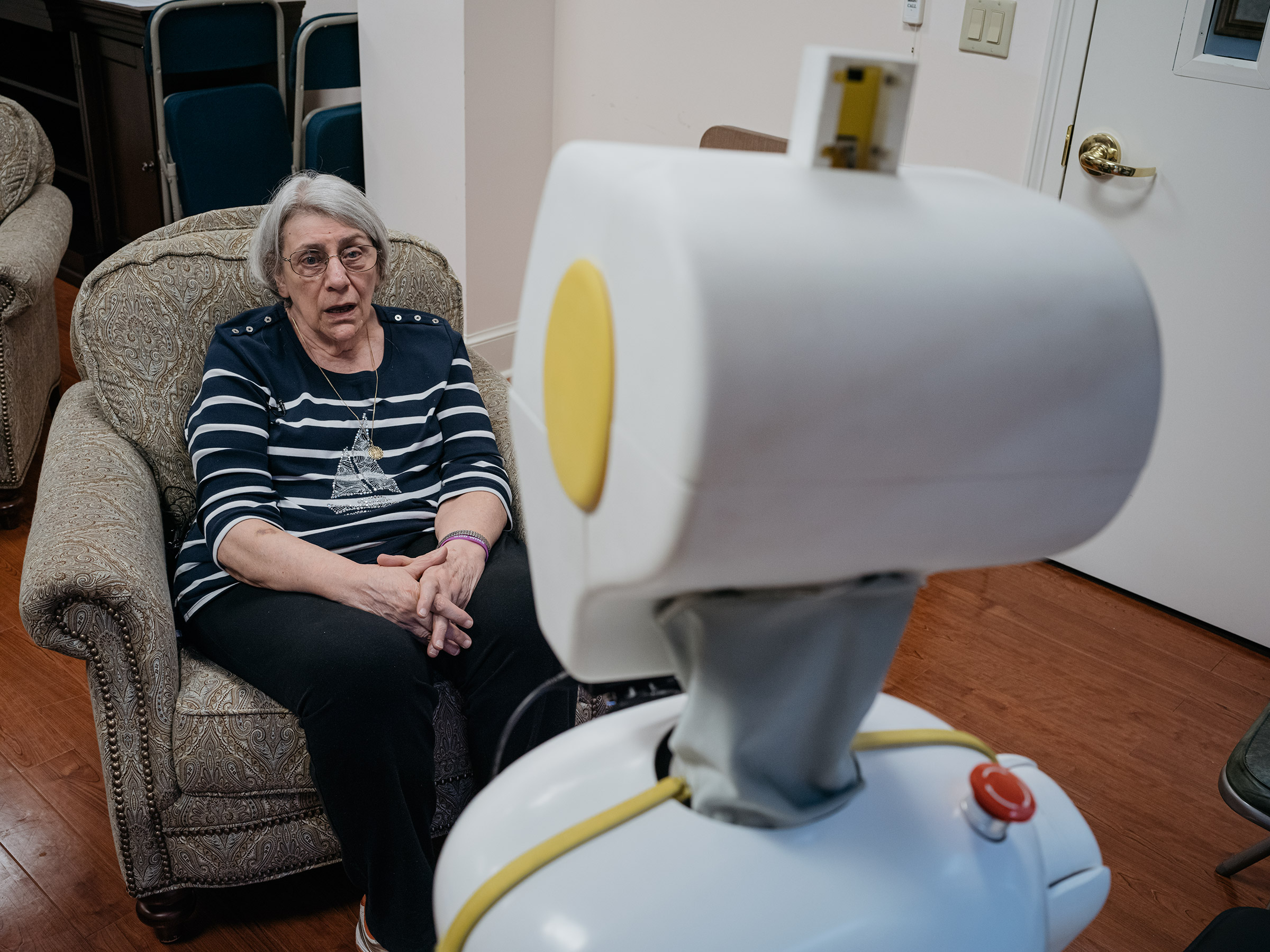 Stevie talks with Betty Bernard while researchers monitor the converstaion at Knollwood Military Retirement Community in Washington, D.C.