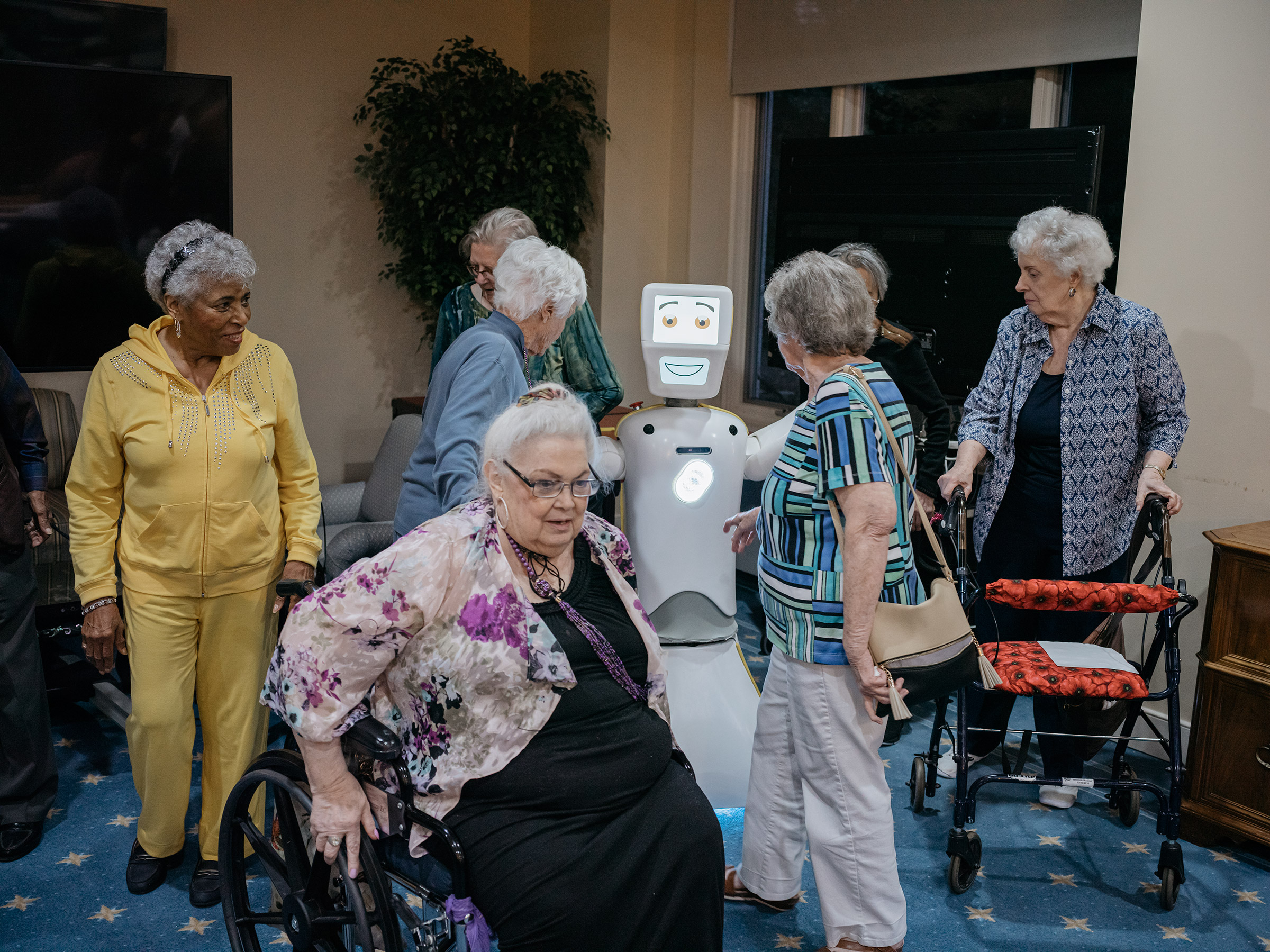 Residents at Knollwood Military Retirement Community in Washington, D.C. gather around Stevie after Bingo night.