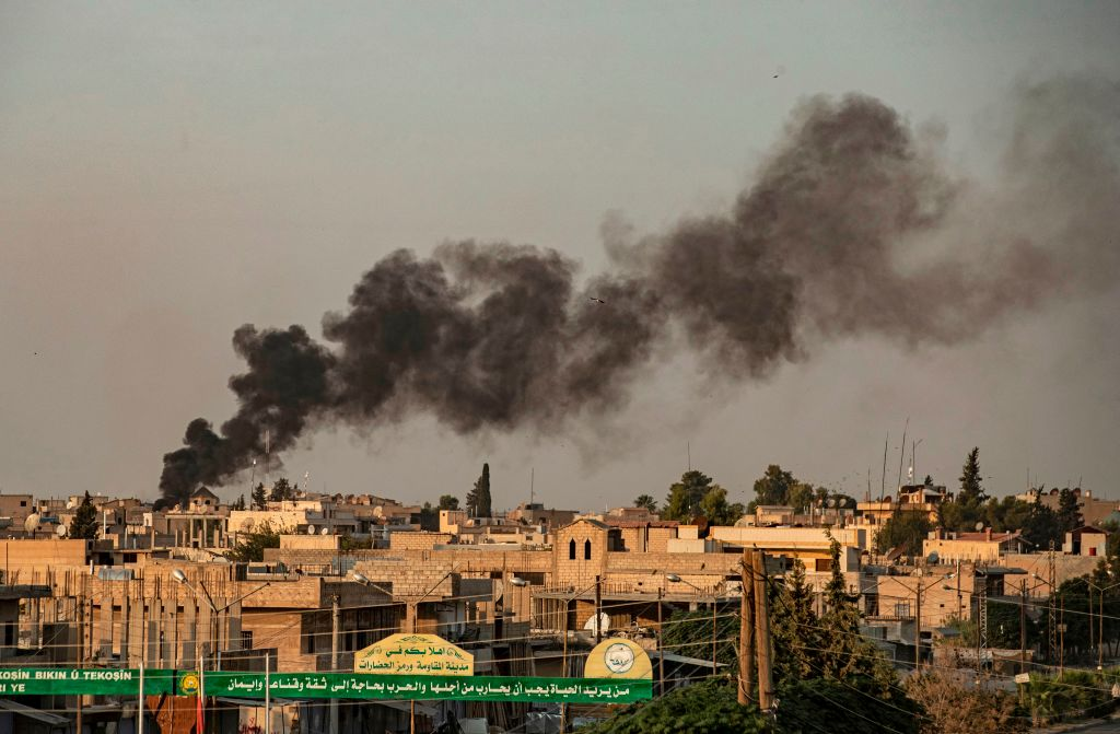 Smoke billows following Turkish bombardment on Syria's northeastern town of Ras al-Ain in the Hasakeh province along the Turkish border on October 9, 2019.