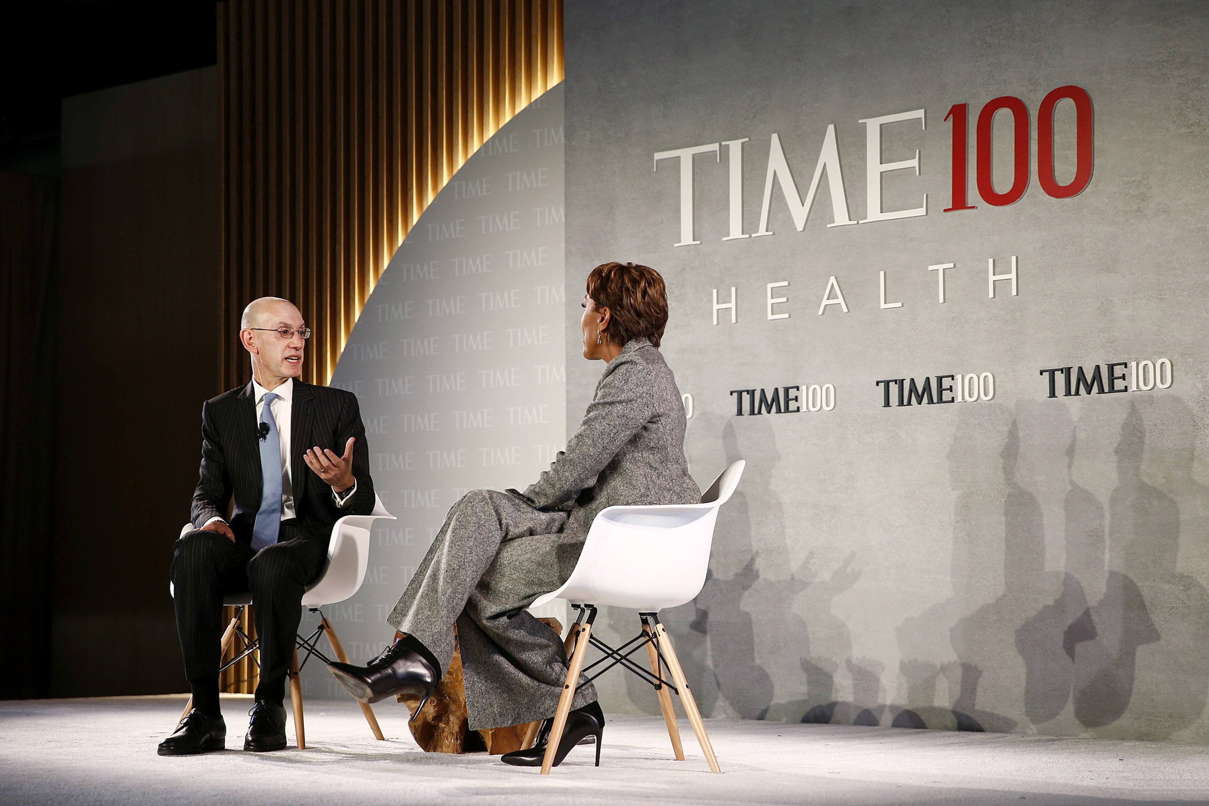 Commissioner of the NBA, Adam Silver (L) and broadcaster Robin Roberts speak onstage during the TIME 100 Health Summit at Pier 17 in New York City on Oct. 17, 2019.