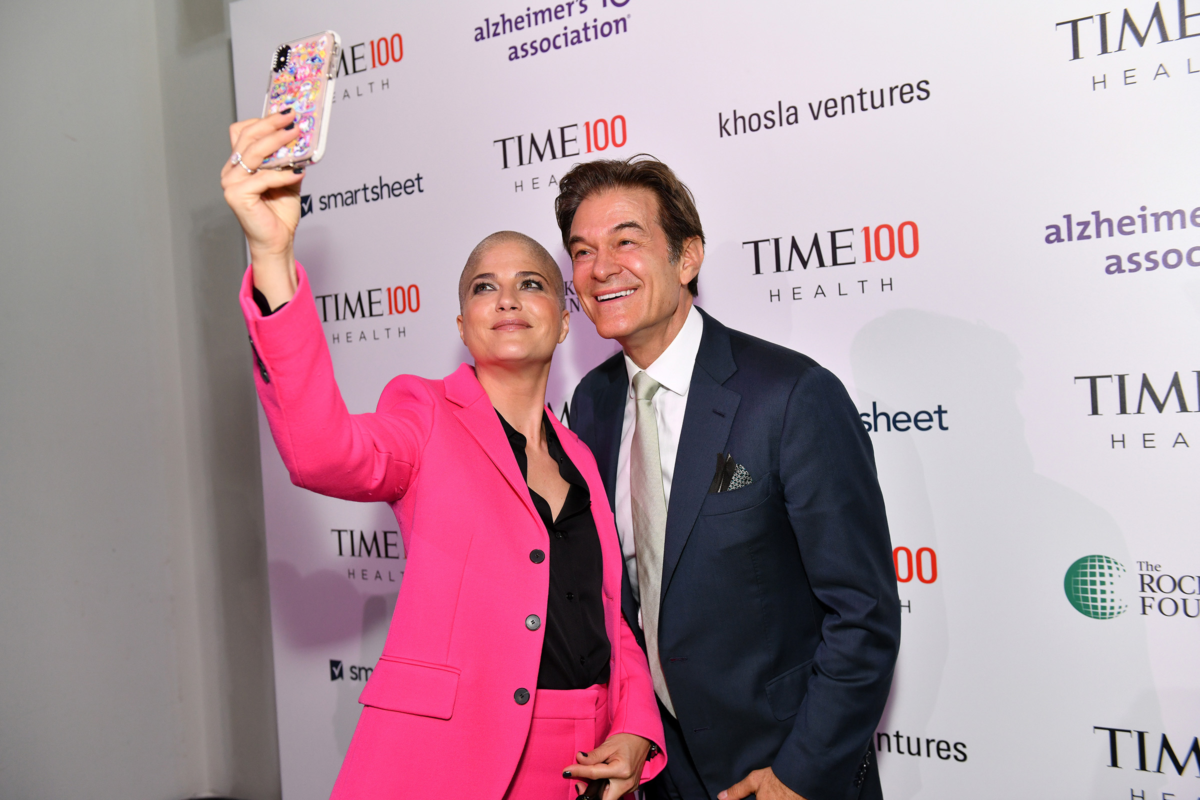 Actor Selma Blair (L) and and Dr. Mehmet Oz arrive at the TIME 100 Health Summit at Pier 17 in New York City on Oct. 17, 2019.
