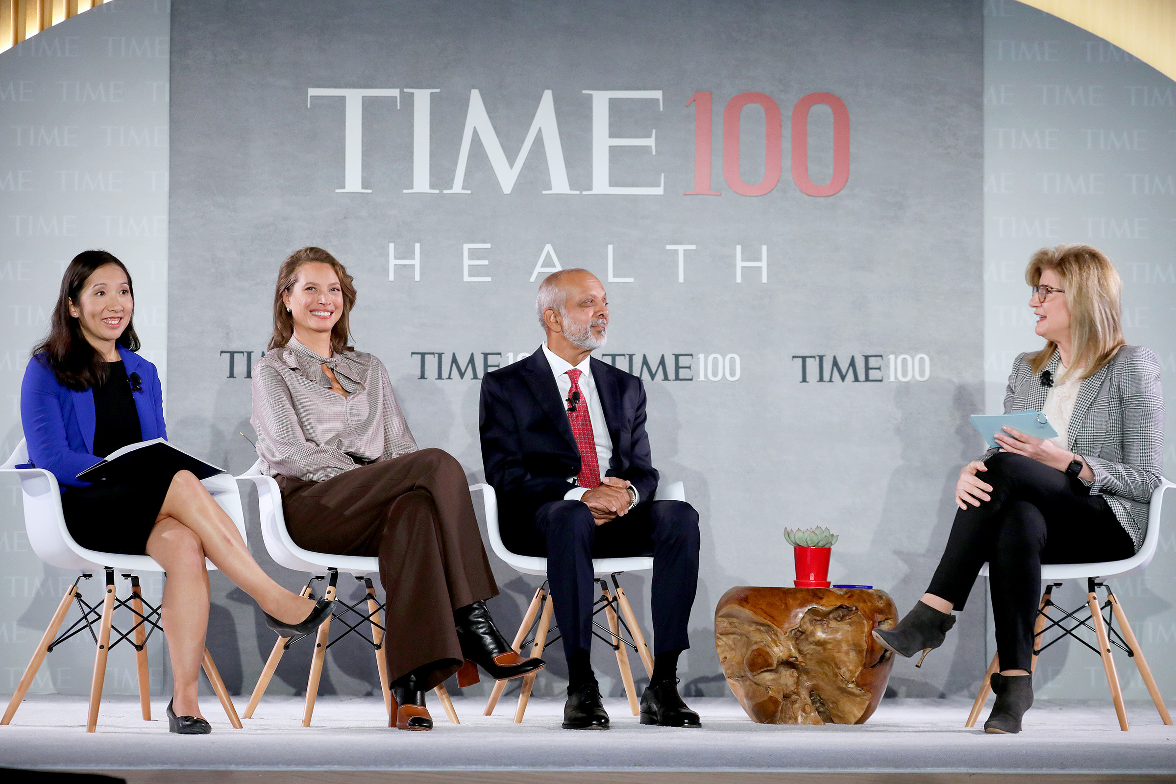 (L-R) Dr. Leana Wen, Christy Turlington Burns, Dr. Naveen Rao and Arianna Huffington speak onstage during the TIME 100 Health Summit at Pier 17 in New York City on Oct. 17, 2019.
