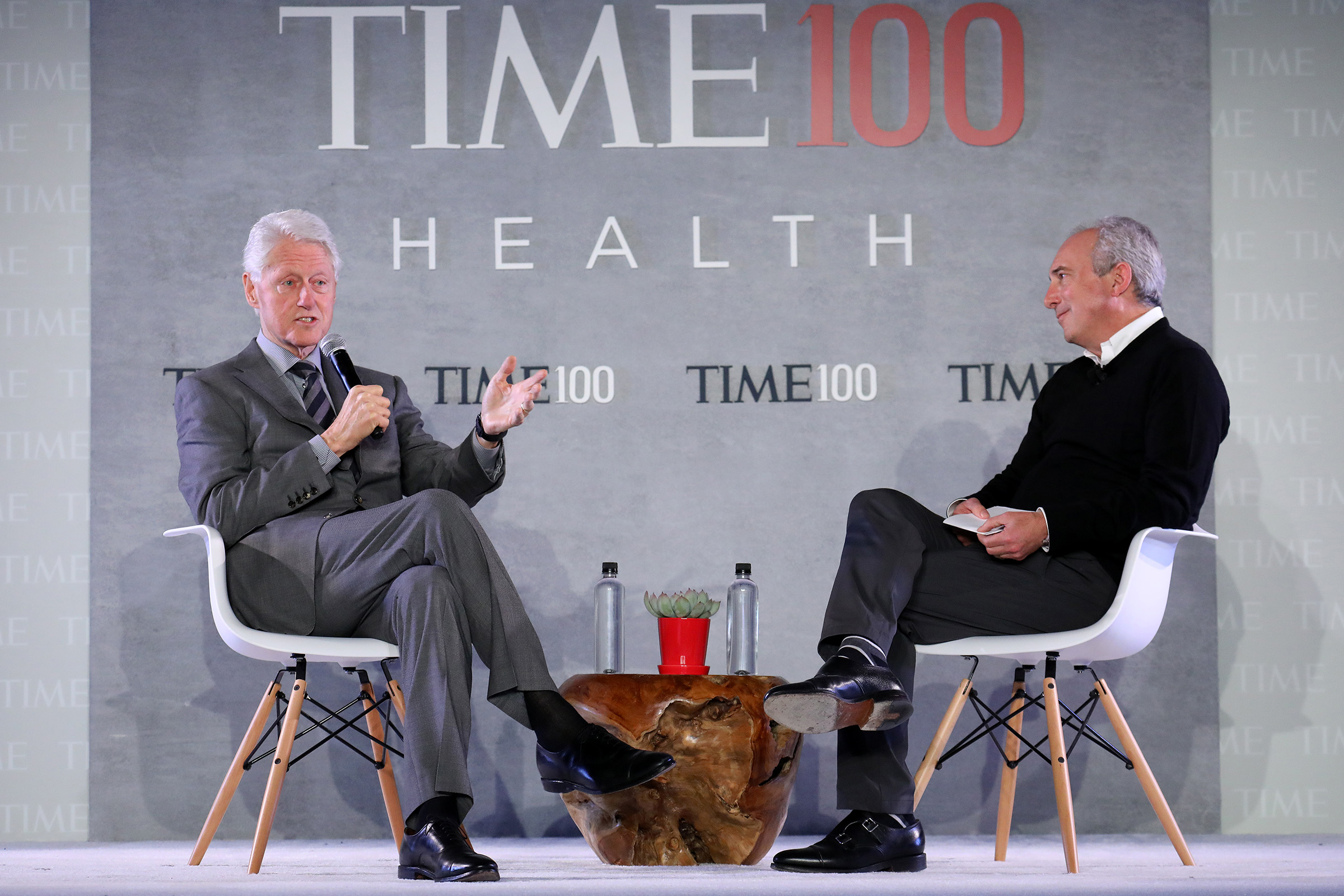 Former U.S. President Bill Clinton (L) speaks with Dr. David Agus,  CEO of the Lawrence J. Ellison Institute for Transformative.Medicine at USC during the TIME 100 Health Summit at Pier 17 in New York City on Oct. 17, 2019.