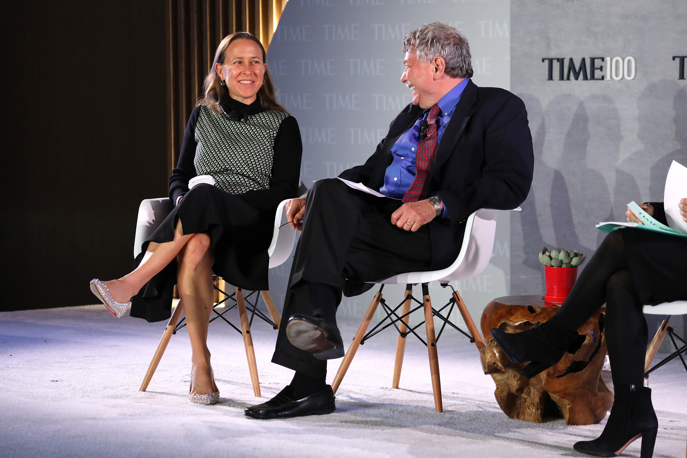 Co-Founder & CEO of 23andMe, Anne Wojcicki (L) and President & Founding Director of the Broad Institute at MIT and Harvard Professor, Eric Lander, speak onstage during the TIME 100 Health Summit at Pier 17 in New York City on Oct. 17, 2019.