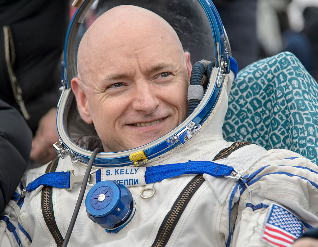 In this handout provided by NASA, Expedition 46 Commander Scott Kelly of NASA rest in a chair outside of the Soyuz TMA-18M spacecraft just minutes after he and Russian cosmonauts Mikhail Kornienko and Sergey Volkov of Roscosmos landed in a remote area on March 2, 2016 near the town of Zhezkazgan, Kazakhstan.