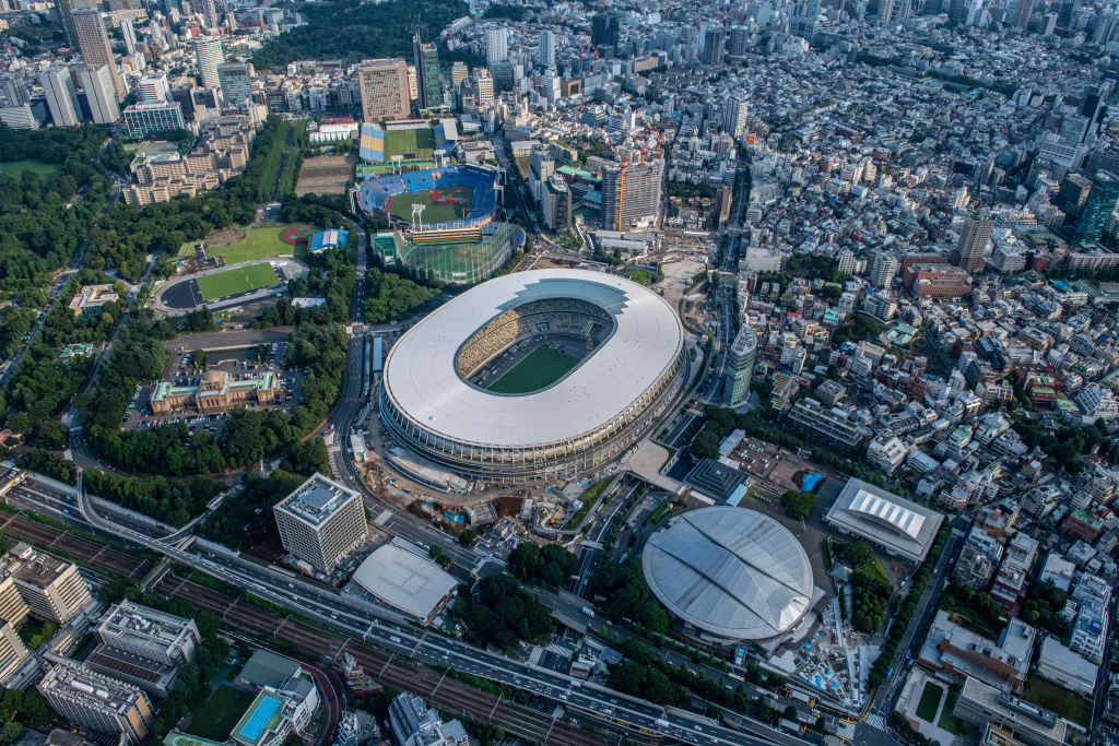 The New National Stadium, the main stadium for the Tokyo 2020 Olympics, and the Tokyo Metropolitan Gymnasium (bottom right) are pictured on July 24, 2019 in Tokyo, Japan.