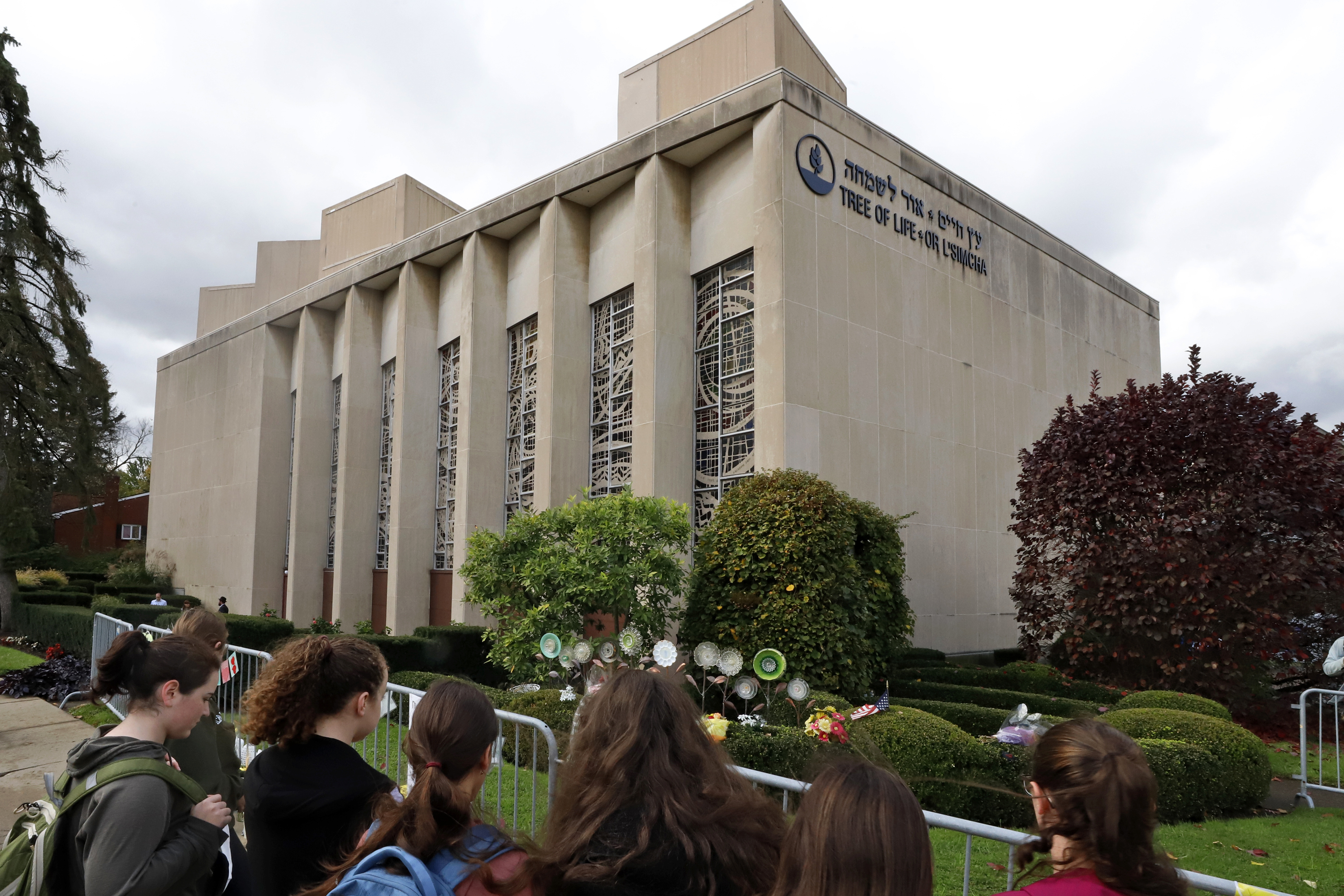 A group of students from a Pittsburgh Yeshiva school gather outside the Tree of Life synagogue in Pittsburgh on Sunday, Oct. 27, 2019, the first anniversary of the shooting at the synagogue, that killed 11 worshippers.