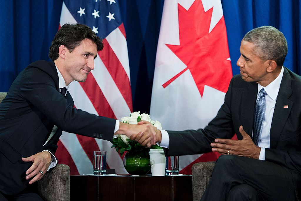 Canada's Prime Minister Justin Trudeau and former U.S. President Barack Obama shake hands at the end of a bilateral meeting at the Asia-Pacific Economic Cooperation summit on Nov. 20, 2016 in Lima, Peru.
